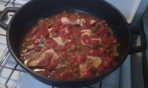 Viel meet with tomatos and olives capers